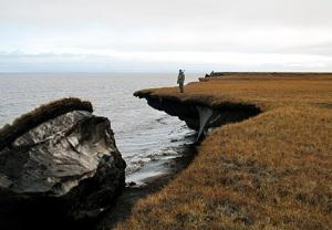Alaska coast ice falls away from land